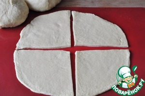 Divide the dough into 3 parts.  Roll out each part and cut into 4 sections.