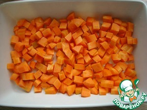 Carrots cut into medium dice and put in a baking dish.