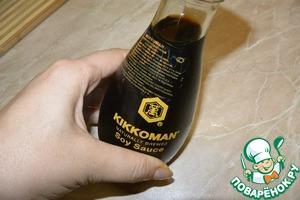 "Measure out a tablespoon of soy sauce TM ""Kikkoman""."