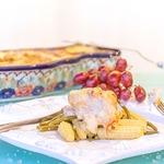 Окунь под сырно-виноградным соусом