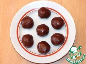 Выложите шоколадные шарики на блюдо и положите в холодильник.