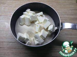 Пока тесто подходит приготовим карамель. Для этого сахар и масло нагреем на плите, пока они не растают.