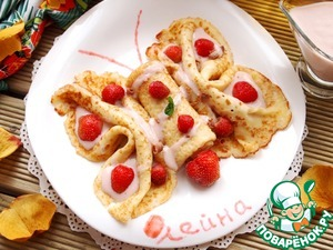Milk custard pancakes with strawberry sauce