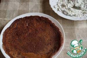 Chocolate pancake dough bake on a greased hot pan pancakes.