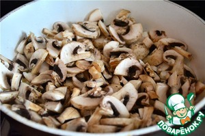 To the onions add the sliced mushrooms. Fry until cooked mushrooms