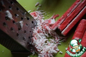 RUB on a coarse grater crab sticks.