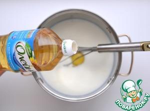 Добавить рафинированное растительное масло «Олейна» (2 ст. л.).    Еще раз взбить венчиком до однородности блинного теста.