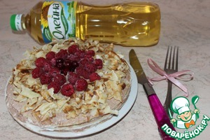 The resulting cake decorate with berries and cut into pieces pancake