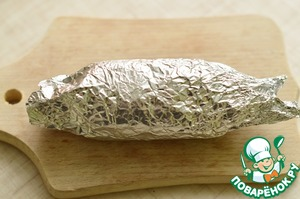 Then gently roll the roulade on the principle rolls. Wrap tightly in foil and put into the freezer for 30 minutes.