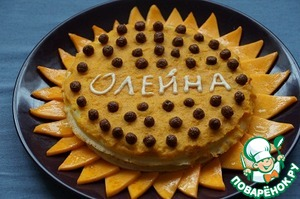 Decorate as desired.  I got on top of chocolate balls for Breakfast around slices of stewed pumpkin, but the inscription is made of white chocolate paste.   The cream gives a very rich taste with a predominance of the orange flavor is set off by the softness of pancakes.  Moderately sweet and fresh at the same time.  Fans of pumpkin will love.