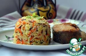 Рыбу подать на блюде вместе с гарниром из риса, украсив зеленью. Приятного аппетита!