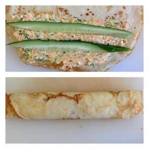 The filling spread to the edge of the pancake. On top lay a couple of sticks of cucumber. Wrap the pancake into a roll.  When serving, cut into portions