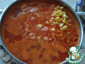 Next lay the corn and shrimp. I added about half a can of corn without liquid. Salt. Simmer the soup until tender about 10 minutes.