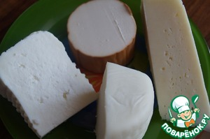Four varieties of cheese - Adyghe, Suluguni, Dutch and Smoked sausage