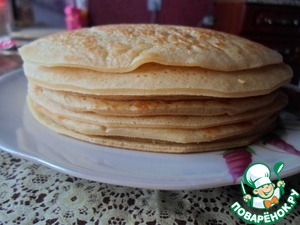 Bake on medium heat without oil on a dry pan a fluffy pancake. I cut the edges to approximately equalize each pancake cake