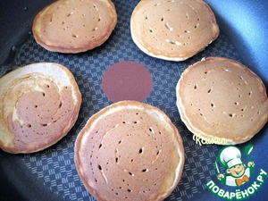 """Bake pancakes on a heated pan, greased with sunflower oil """"generous gift""""."""