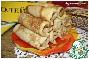 Folded pancakes on a plate slide.