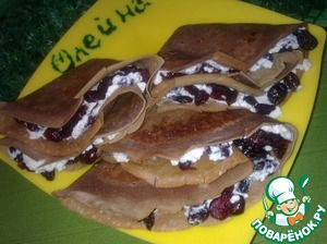 Chocolate pancakes with cottage cheese and dried cranberries ready. Help yourself!