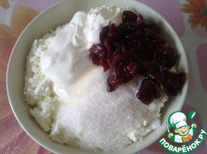 Add sour cream, sugar and some dried cranberries. Mix well.