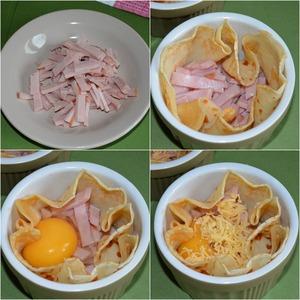 Готовим первый завтрак.   Ветчину (колбасу, сосиски, сардельки или что вам вкуснее) нарезать кубиками или брусочками. Затем разложить по формам на блинчики.    Далее в каждый блинчик на ветчину вбить по яйцу. Делать это надо аккуратно, чтобы яйцо не вытекло из блинчика. И желательно, чтобы желток остался целый.    По вкусу посолить и добавить черный молотый перец.   Сверху присыпать тертым сыром.   Если края блинчиков сильно выступают из формы, то смажьте их растительным маслом.    Далее отправить формы в прогретую духовку. Ориентировочное время - 10 минут.