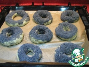 Baking tray lay a baking paper. Bagels be positioned at a distance of 3 cm from each other