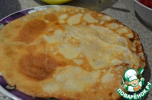 And fry our pancakes in a hot pan. The first time the pan I greased with butter.  The dough is very tender and pancakes can break. If they are hard to break add a bit more flour.