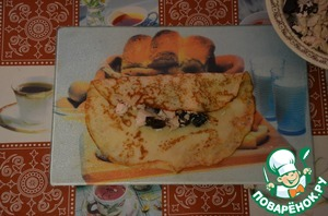 Spread the filling onto the pancake.