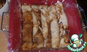 Shape cover with cling film and put the pancakes tightly to each other. Pour kefir-sour cream mixture and put into the refrigerator to solidification