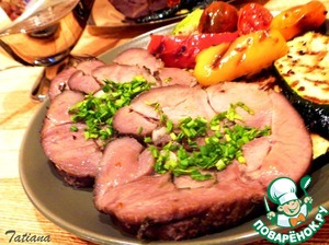 Prepared meat remove from oven, remove the dressing cord, cut into portions, serve with grilled vegetables.   BON APPETIT!