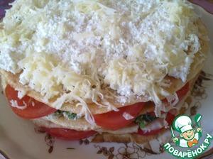 Укладываем ряды торта, пока не закончатся блины. Последний блин смазываем сырным кремом и посыпаем его сыром.   Запечь при 175°С 20-25 минут, затем в режиме гриль — еще 2-3 минуты.