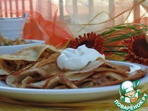 Serve the stuffed pancakes and sour cream. Bon appetit!