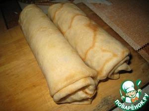 Блинчики поместить в духовку на 10 минут при 180 градусах, чтобы расплавился сыр.