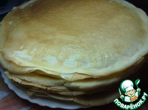 """Make the dough for pancakes, add sunflower oil TM """"generous gift"""". Bake pancakes according to your favorite recipe."""