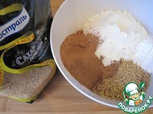 Орехи измельчим в блендере. Смешаем муку, разрыхлитель, какао-порошок и измельчённые орехи.