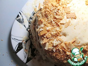 Decorate the top and sides of cake with chopped pieces of dough set overnight in the fridge.
