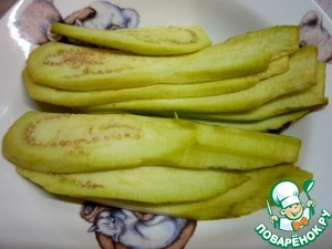 Eggplant peel and cut into long strips.