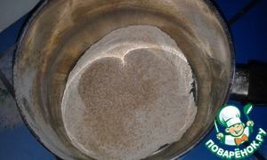 The flour and bran sifted through a sieve