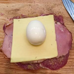 Put ham, cheese, egg.