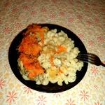 Хек, тушенный с луком и морковью