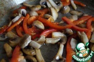 Then add the mushrooms to the pepper and fry for another 1 minute.