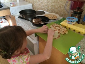 When stuffing is slightly cooled, begin to fill the pancakes with filling. Just put the stuffing and twist the tube