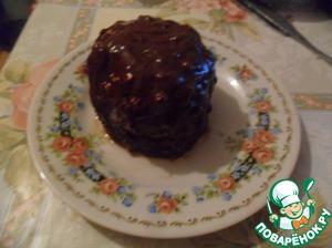 Тем временем ломаем шоколад на дольки, добавляем масло. Ставим в выключенную духовку на 10 мин, перемешиваем, заливаем яблоко. Наше блюдо готово! Приятного аппетита!