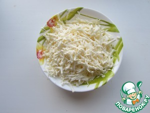 While vegetables cook, grate cheese