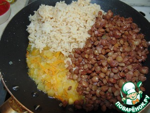 To the sauteed vegetables add the lentils and rice.