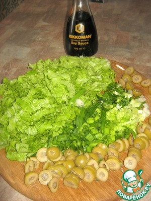 Chop lettuce, olives, green onions