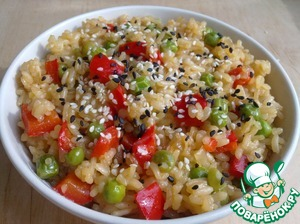 Spread the cooked rice in portion dishes and sprinkle with sesame seeds. Bon appetit!
