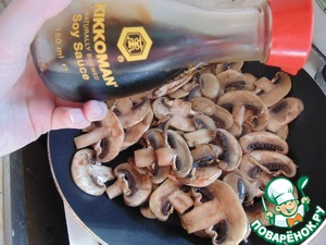 Add in mushrooms soy sauce Kikkoman. Stir and cook for another 3 minutes.