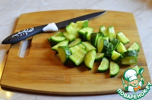 Chop the cucumber and add to potatoes.