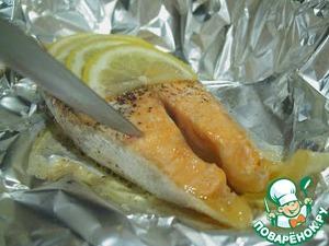 Рыба получается сочная, тушеная в лимонном соке.