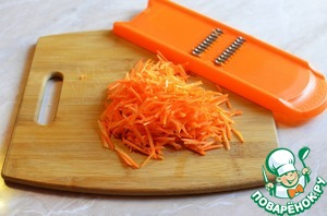 Peel the carrot and grate
